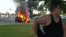 Disabled man pulled from car moments before it bursts into flames