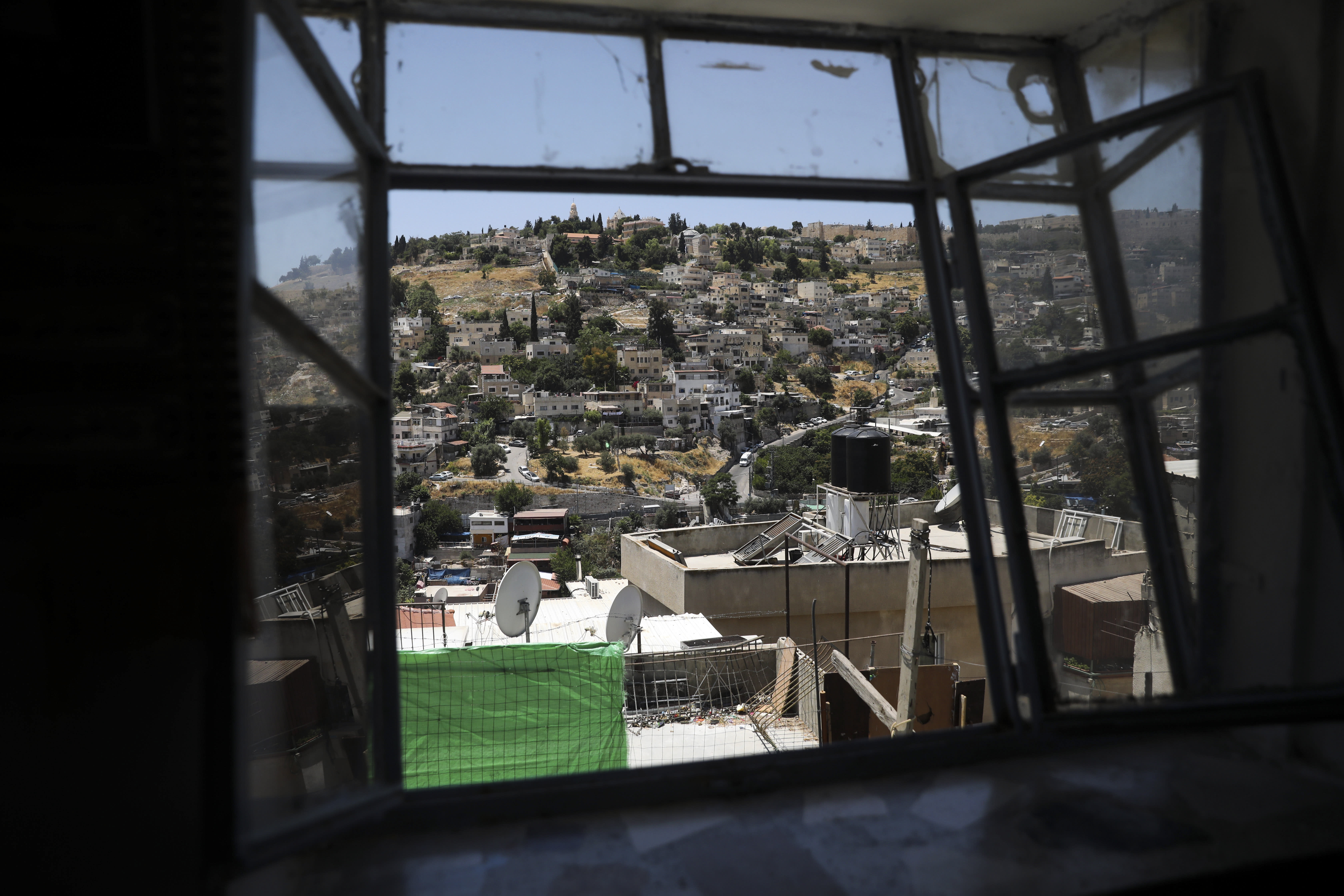 """A general view of a Palestinian neighborhood of Silwan in east Jerusalem, seen on Wednesday, July 1, 2020. Israeli leaders paint Jerusalem as a model of coexistence, the """"unified, eternal"""" capital of the Jewish people, where minorities have equal rights. But Palestinian residents face widespread discrimination, most lack citizenship and many live in fear of being forced out. (AP Photo/Mahmoud Illean)"""