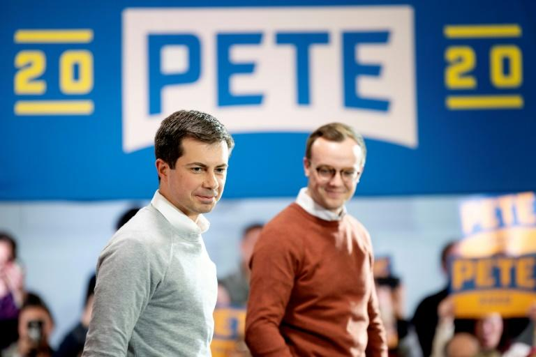 Democrat Pete Buttigieg (L) pictured in November 2019 with his husband Chasten in New Hampshire, is soaring up the polls (AFP Photo/JIM WATSON)