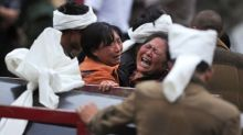 Hopes fade in China as more landslide victims found with over 100 missing