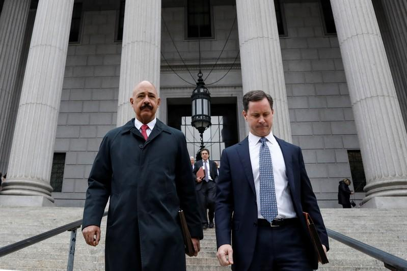 Theodore Wells, the lawyer for Exxon, exits New York State Supreme Court in New York