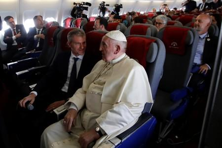 Pope Francis talks with his spokesperson Matteo Bruni during his flight from Antananarivo to Rome