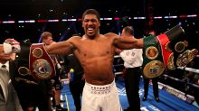 Joshua retains heavyweight titles with TKO