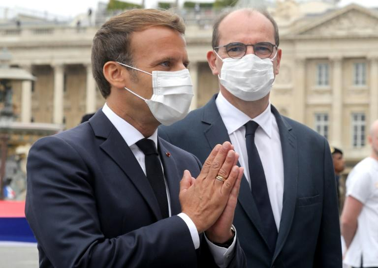 """French President Emmanuel Macron said: """"I would like to make masks mandatory in all enclosed public spaces"""" (AFP Photo/Ludovic Marin)"""