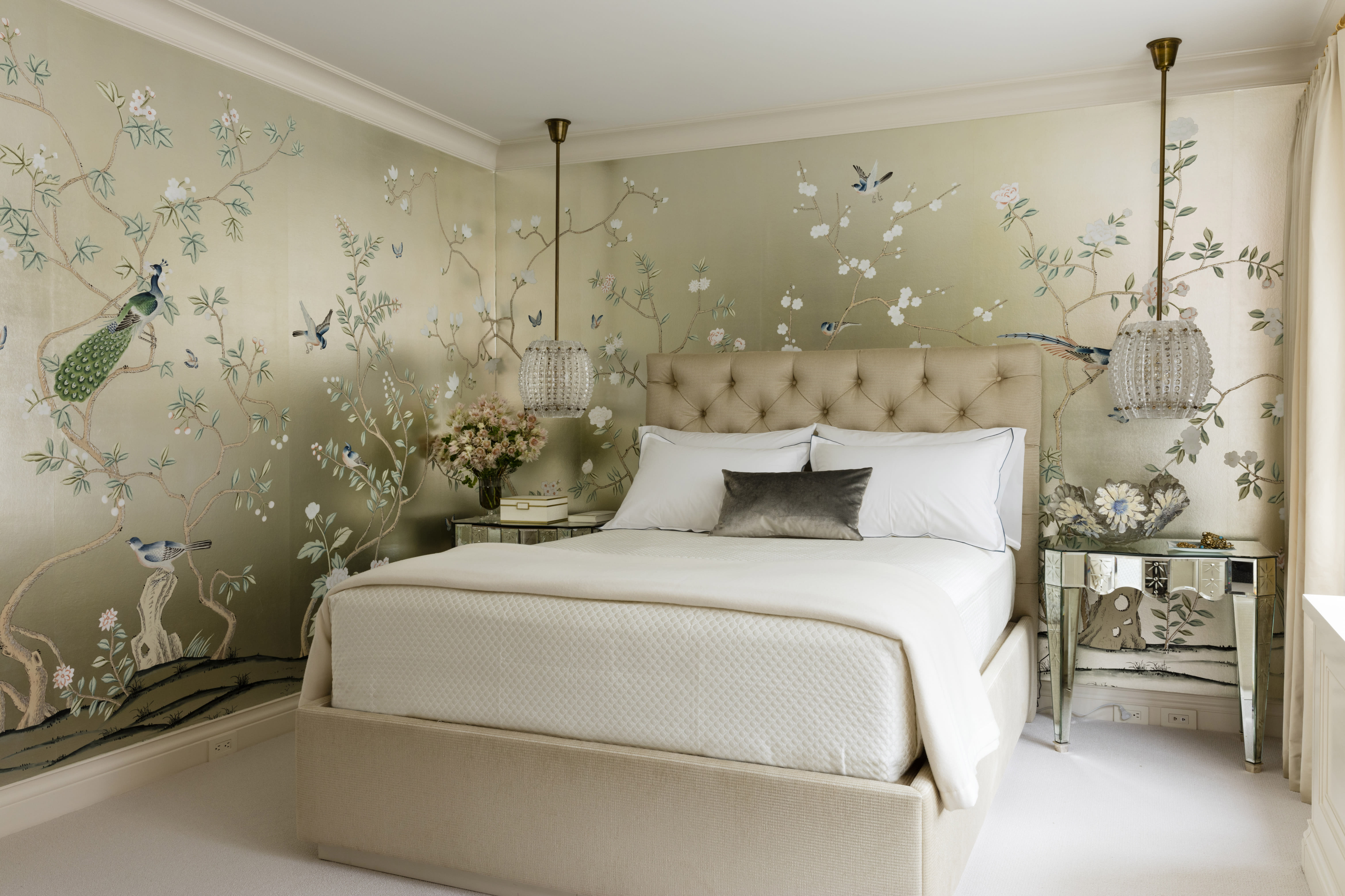 """This undated photo provided by Craig & Company shows a master bedroom that interior designer Joan Craig designed for a New York client. Craig used a hand-painted Chinoiserie gilded silk from de Gournay. """"Wallpaper is having its day,"""" says Craig. """"We can't get enough of it and neither can our clients."""" Antoine Bootz/Craig & Company via AP)"""