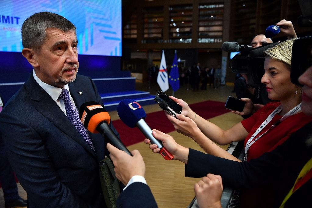 Czech Republic's Prime Minister Andrej Babis (L) is among populist politicians who have been critical of the media