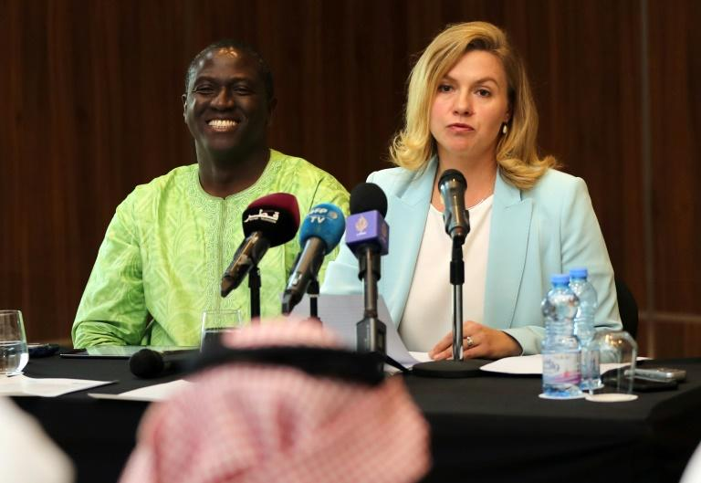 UN independent human rights experts, Elina Steinerte of Latvia and Roland Adjovi of Benin, address the media in the Qatari capital Doha on November 14, 2019 (AFP Photo/KARIM JAAFAR)