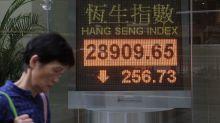 Asian, European stocks fall as markets await US tax deal