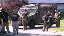 Home invasion suspects locked in police standoff