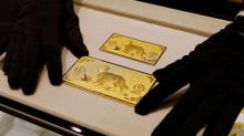Gold edges higher as stocks slide; metal heads for third weekly gain