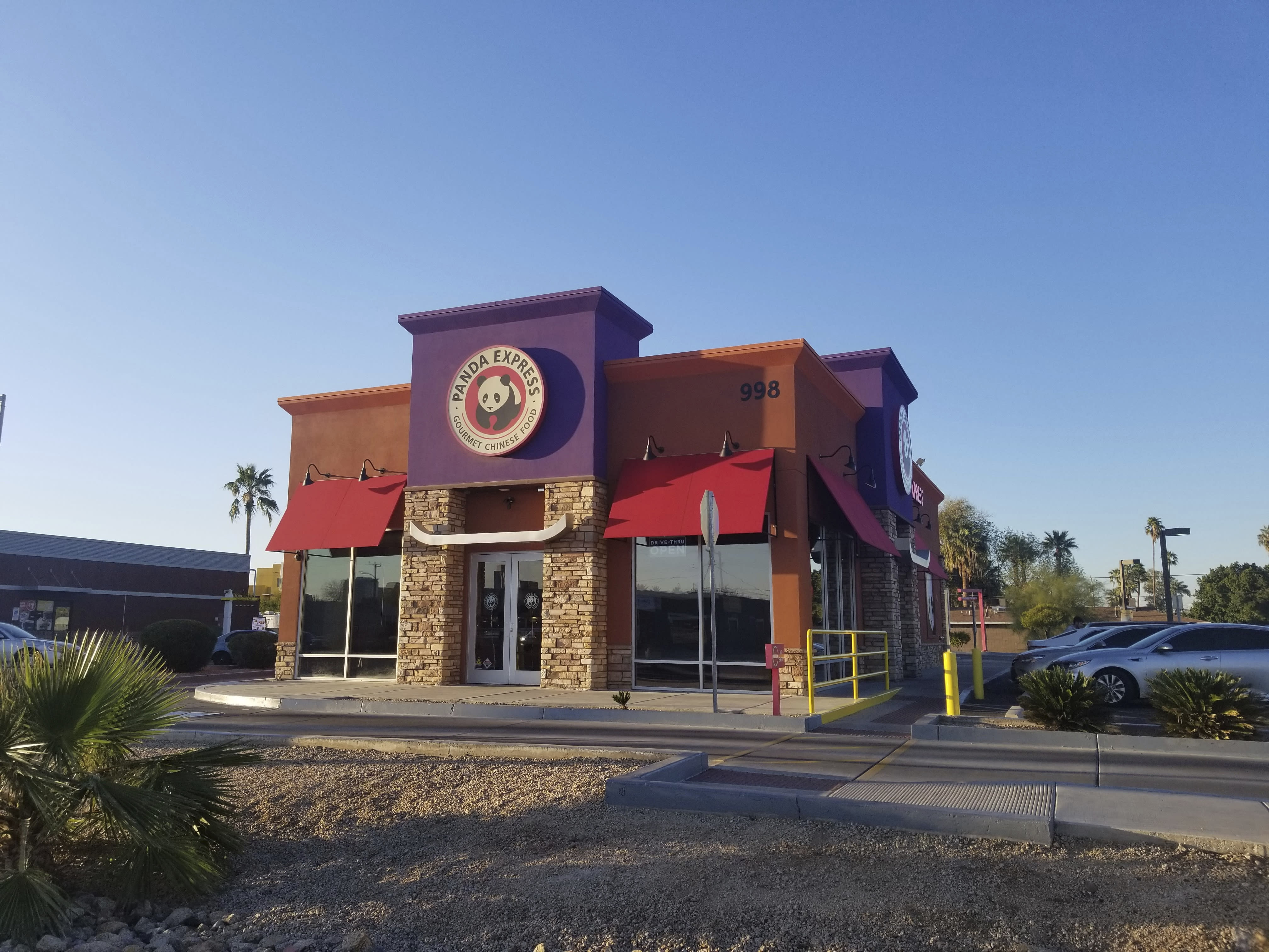 """This March 4, 2020 photo shows a Panda Express restaurant in Phoenix. Getting a trademark for the new name can lead to ugly and sometimes public clashes over ownership and cultural appropriation. In recent years, businesses have butted heads over whether a restaurant or food truck can legally own the right to use words rooted in Asian American Pacific Islander cultures like """"aloha"""" and """"poke."""" (AP Photo/Terry Tang)"""