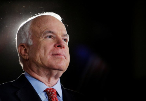 Republican presidential nominee Senator John McCain (R-AZ) listens as he is being introduced at a campaign rally in Denver, Colorado October 24, 2008.
