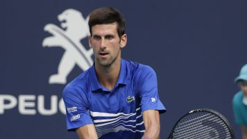 Djokovic smashes racket in scrappy win
