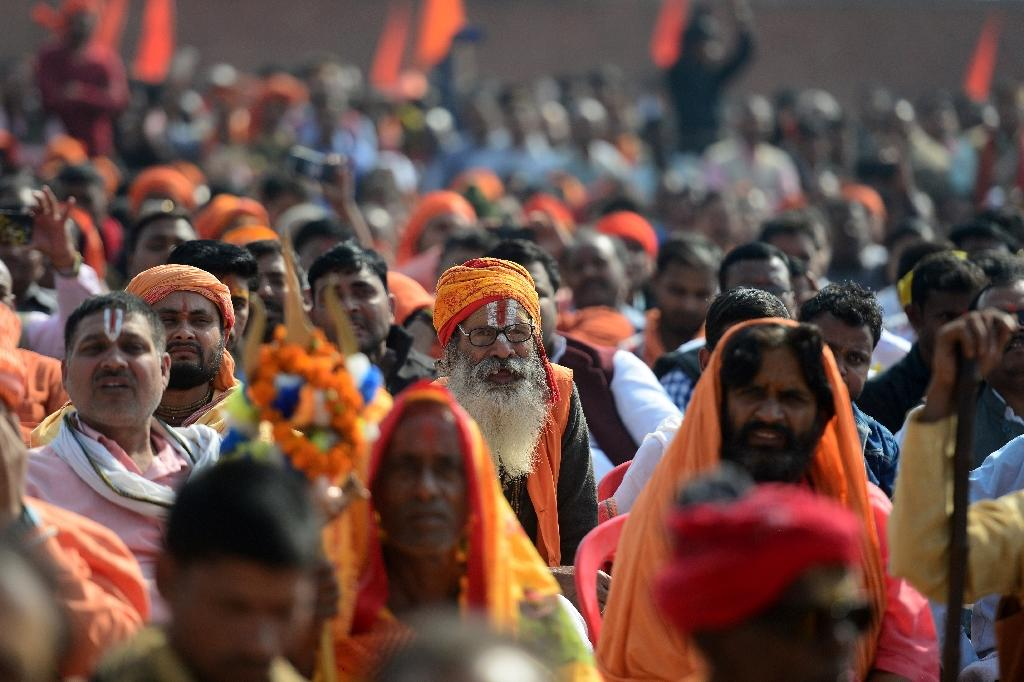 Indian Sadhus attend the 'Dharam Sabha' Hindu congregation held to call for the construction of a grand temple of Lord Rama on the site of a former mosque (AFP Photo/SANJAY KANOJIA)