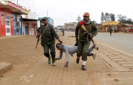Congolese soldiers arrest a civilian protesting against the government's failure to stop the killings and inter-ethnic tensions in the town of Butembo