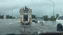 Trucks Plow Through Floodwaters at Ayr in North Queensland