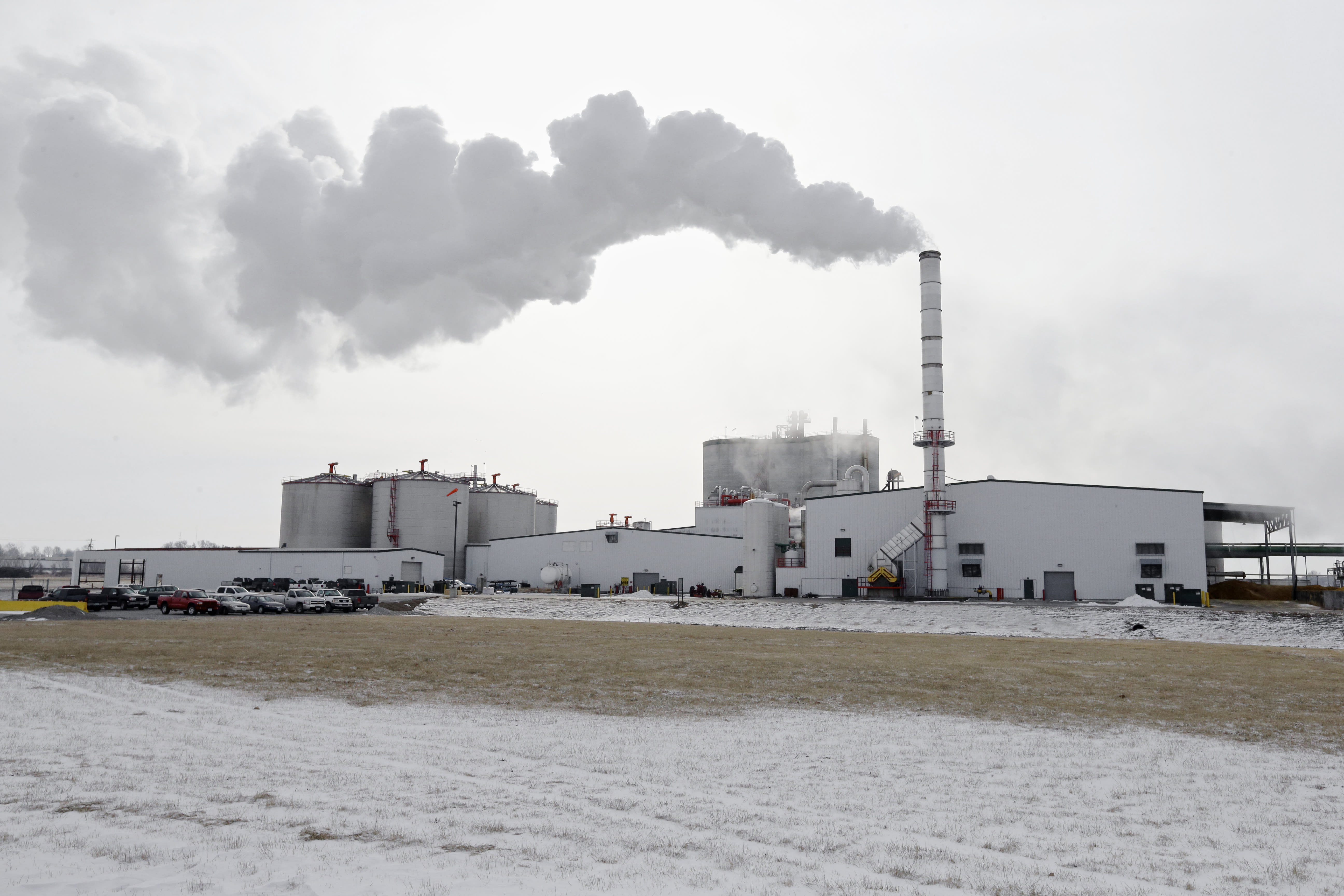 FILE - In this Jan. 6, 2015 file photo steam blows over the Green Plains ethanol plant in Shenandoah, Iowa. As hospitals and nursing homes run out of hand sanitizer to fight off the coronavirus, struggling ethanol producers are eager to help. They could provide alcohol to make millions of gallons of the germ-killing sanitizer, but the U.S. Food and Drug Administration has put up a roadblock, frustrating both the health care and ethanol industries with its inflexible regulations during a national health care crisis. (AP Photo/Nati Harnik, file)