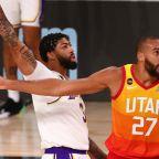 Davis double-double helps Lakers clinch top seed in West, VanVleet and Raptors cool Heat