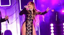 Jennifer Lopez Rocks Super Sexy Double Thigh-High Cutout Dress for Latest Performance