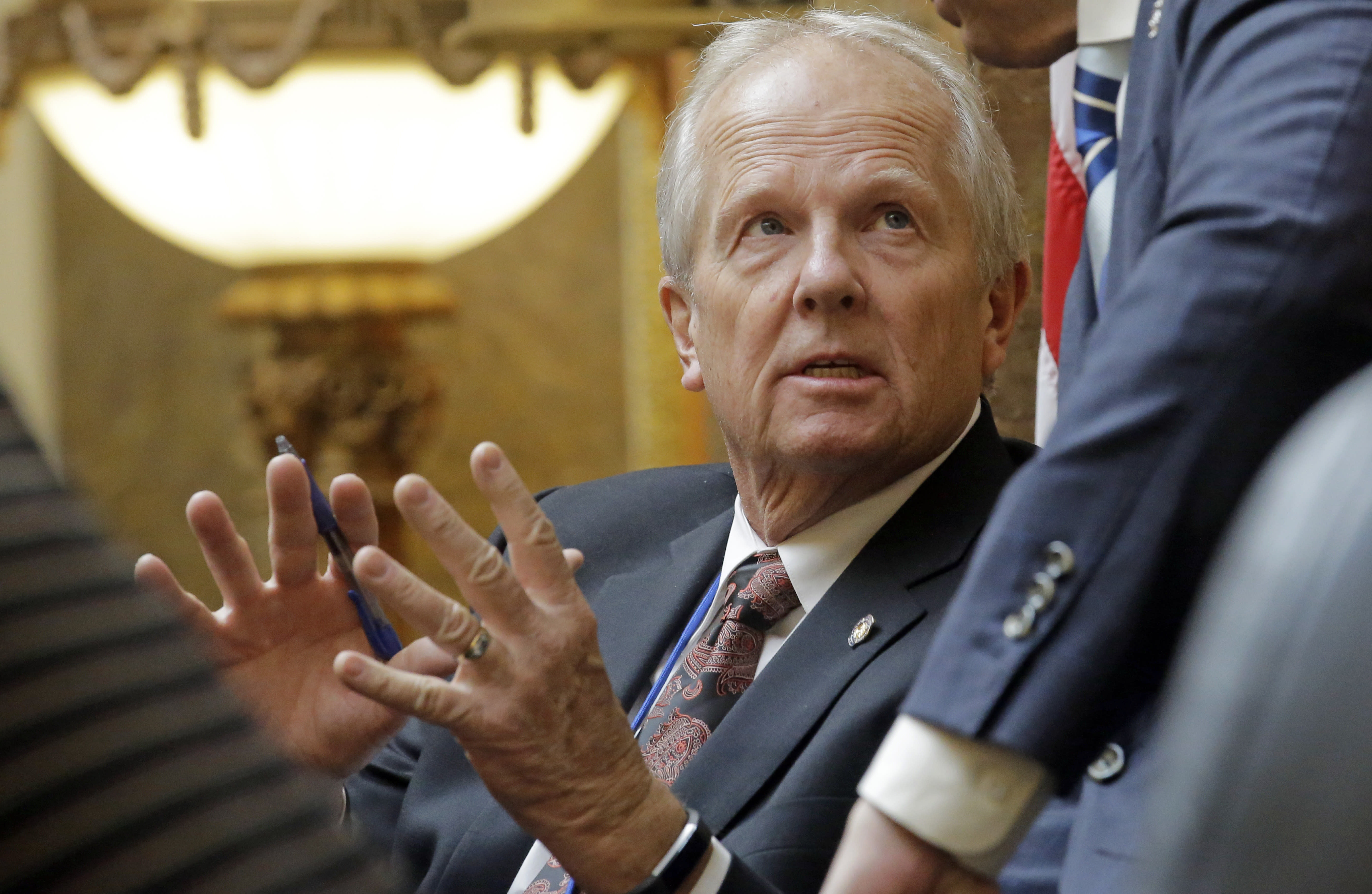 FILE - This Feb. 8, 2017, file photo, Rep. Mike Noel, R-Kanab, speaks on the House floor at the state Capitol in Salt Lake City. An internal watchdog has cleared Interior Secretary Ryan Zinke of wrongdoing following a complaint that he redrew the boundaries of a national monument in Utah to benefit a former state lawmaker and political ally. The Interior Department's office of inspector general says it found no evidence that Zinke gave former state Noel preferential treatment in shrinking the boundaries of Utah's Grand Staircase-Escalante National Monument.(AP Photo/Rick Bowmer, File)