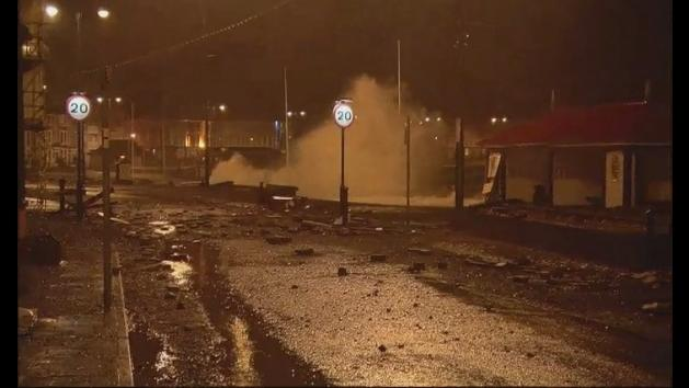 Storm leaves slabs scattered across Aberystwyth sea front