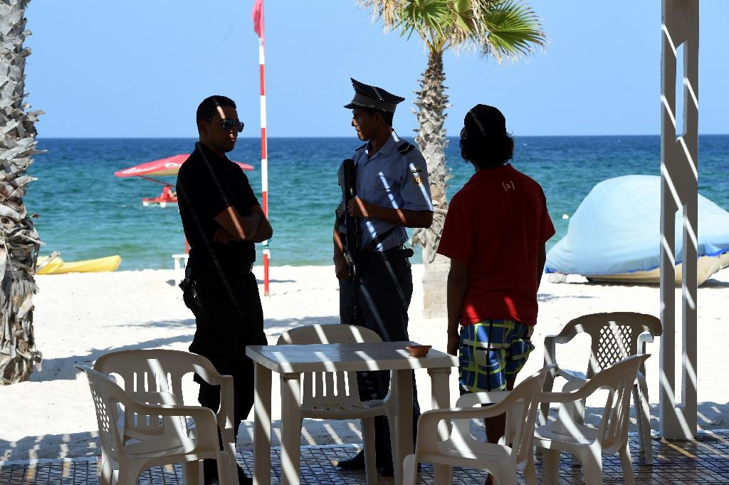A Tunisian policeman stands guard on July 10, 2015 in the Mouradi Hotel near Sousse in the wake of the beach massacre