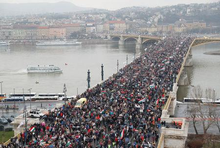 Tens of thousands march to back Hungarys nationalist PM before vote