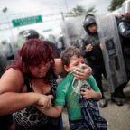 Migrant caravan streams out of Guatemala, halted by Mexican police