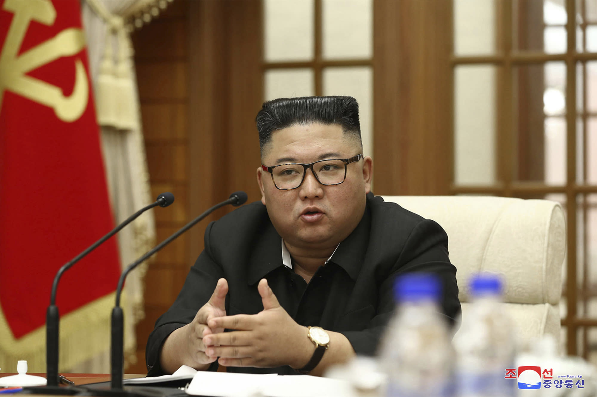 """In this photo provided Wednesday, Sept. 30, 2020, by the North Korean government, North Korean leader Kim Jong Un attends the 18th meeting of Political Bureau of 7th Central Committee of the Workers' Party of Korea in Pyongyang, Tuesday, Sept. 29, 2020. Independent journalists were not given access to cover the event depicted in this image distributed by the North Korean government. The content of this image is as provided and cannot be independently verified. Korean language watermark on image as provided by source reads: """"KCNA"""" which is the abbreviation for Korean Central News Agency. (Korean Central News Agency/Korea News Service via AP)"""