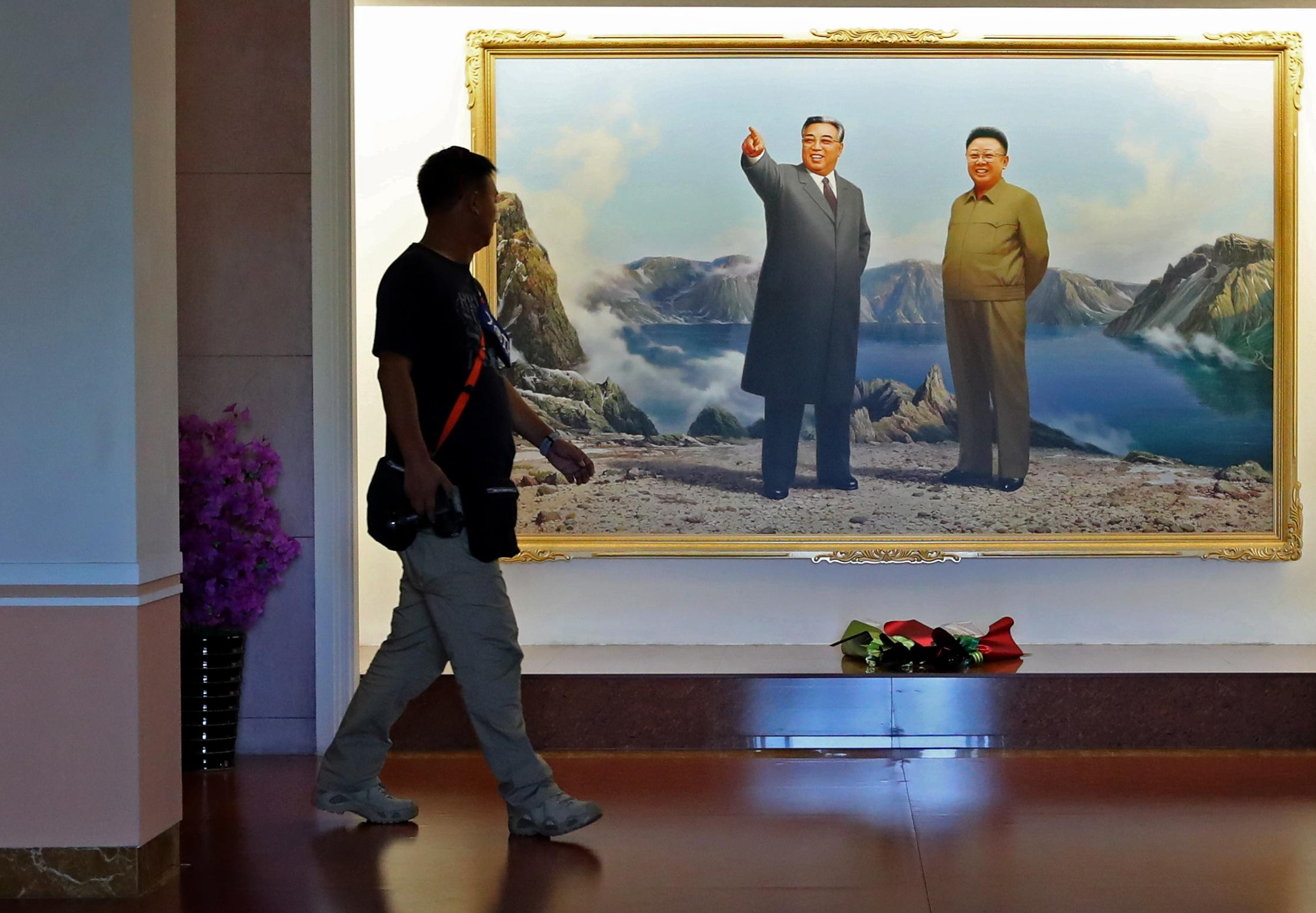 PYONGYANG, NORTH KOREA - SEPTEMBER 7, 2018: Portraits of former North Korean leaders Kim Il-sung (L) and Kim Jong-il on display inside a cosmetics factory building in Pyongyang. Alexander Demianchuk/TASS (Photo by Alexander Demianchuk\TASS via Getty Images)