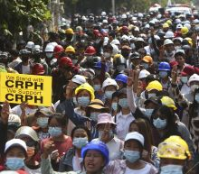 Protests, tear gas in Myanmar after UN envoy urges action