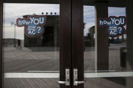 Stickers are seen on the closed doors of a casino in Atlantic City, New Jersey, January 20, 2016. REUTERS/Shannon Stapleton