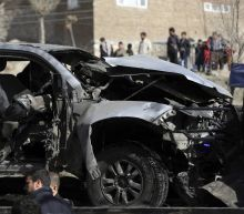 Official: 2 insider attackers kill 12 Afghan militiamen