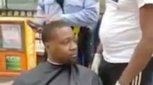 Police try to shut down a man giving homeless people haircuts in viral video