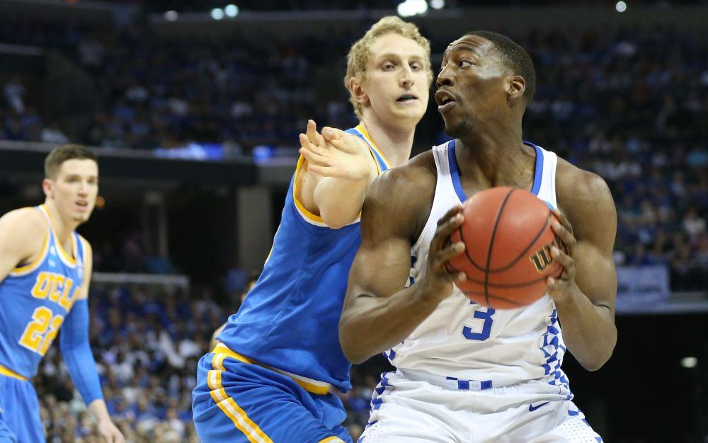 Kentucky Wildcats forward Edrice Adebayotries to drive against UCLA Bruins centre Thomas Welsh - USA Today Sports