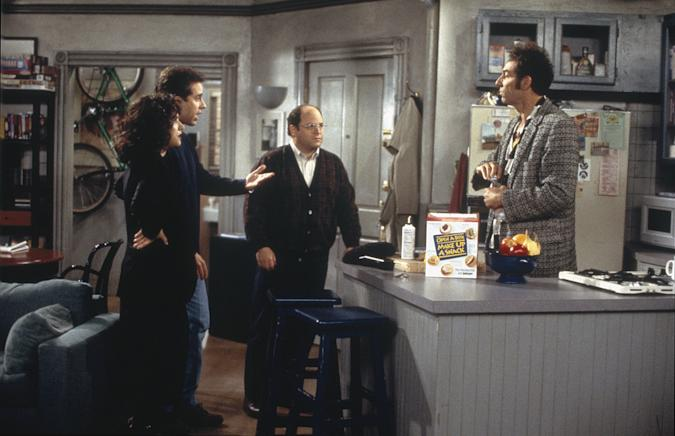 """SEINFELD -- """"The Burning"""" Episode 16 -- Pictured: (l-r) Julia Louis-Dreyfus as Elaine Benes, Jerry Seinfeld as Jerry Seinfeld, Jason Alexander as George Costanza, Michael Richards as Cosmo Kramer -- Photo by: Joey Delvalle/NBCU Photo Bank"""