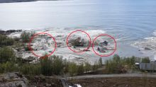 Incredible moment landslide drags several homes into the sea