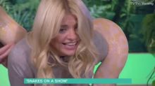 WATCH: Holly Willoughby panic live on This Morning as a REAL SNAKE wraps itself round her leg