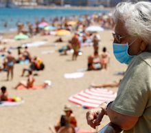 Spain's foreign minister urges British government to reconsider holiday quarantine