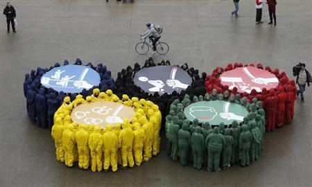 Olympic rings are displayed as part of a protest by human rights organisations a week before of The Sochi winter Olympic Games in Paris