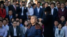 South Korea opposition party leader shaves head in protest