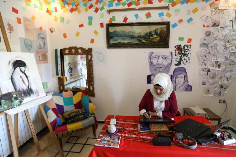 Before civil war erupted in 2011, Ali worked as an art teacher at a private school in Idlib (AFP Photo/Omar HAJ KADOUR)