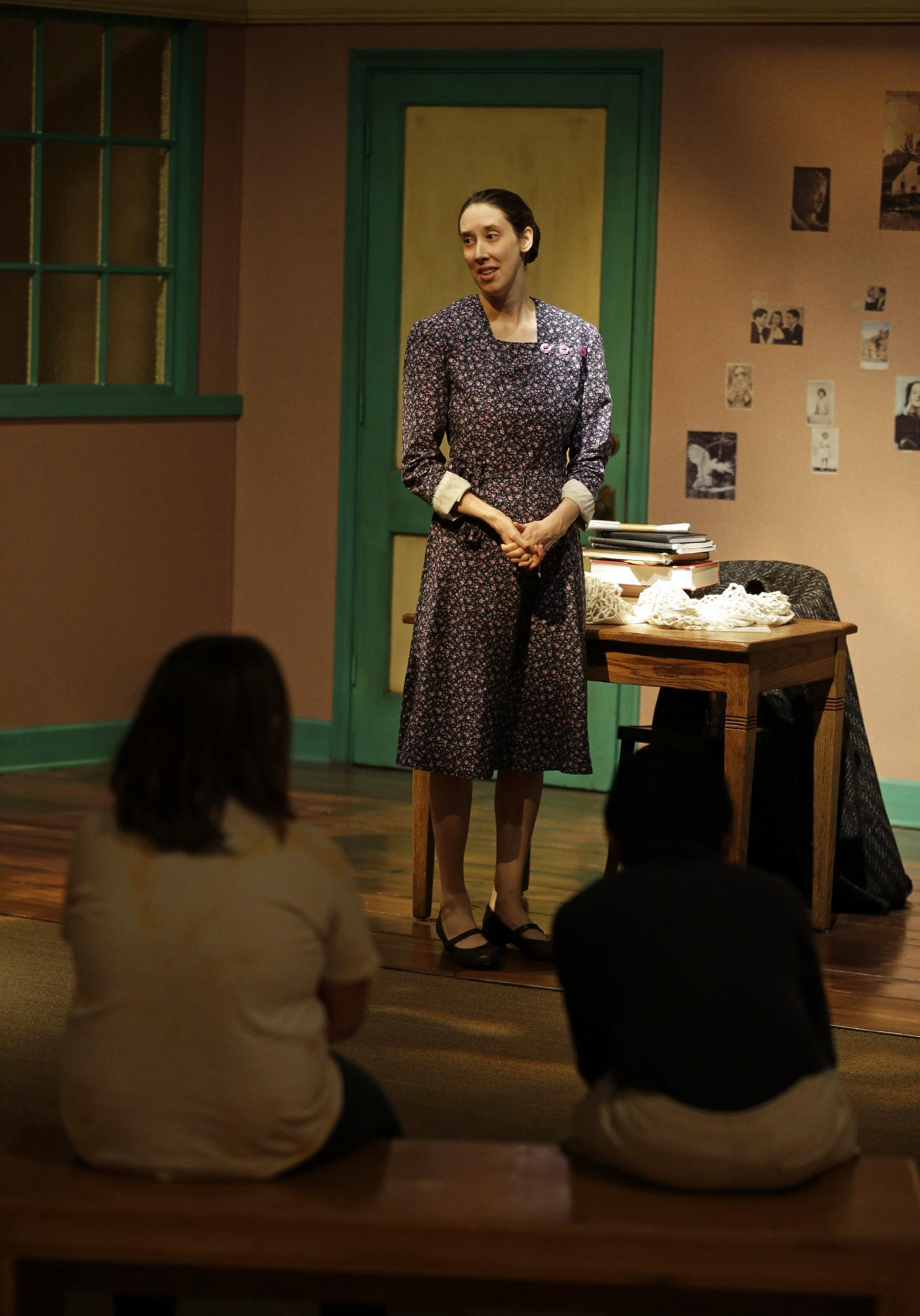 In this Monday, March 18, 2013 photo, actress Julie Mauro portrays Miep Gies, one of Anne Frank's protectors and the woman who preserved her diary, during a performance in an Anne Frank exhibition at the Indianapolis Children's Museum in Indianapolis. Eleven saplings grown from seeds taken from the massive chestnut tree that stood outside the home in which Frank and her family hid are being distributed to museums, schools, parks and Holocaust remembrance centers through a project led by The Anne Frank Center USA. (AP Photo/Michael Conroy) (AP Photo/Michael Conroy)