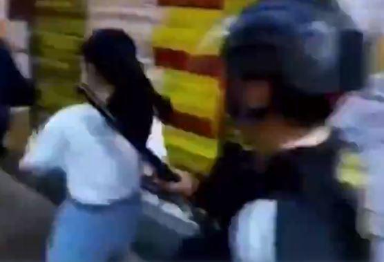 Hong Kong police defend tackling 12-year-old girl to the ground