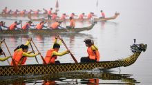 Dragon boat race splashes into Hanoi