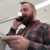 Kmart employee chokes up as he makes his final announcement before the store closes permanently
