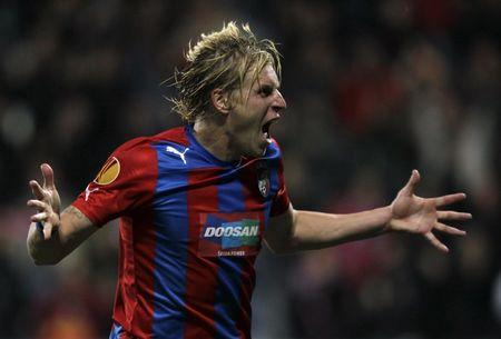 Viktoria Plzen's Rajtoral celebrates after scoring against Academica during their Europa League soccer match in Plzen