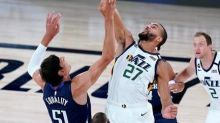 Short-handed Mavericks use huge rally to beat Jazz 122-114