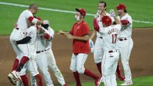 Votto's double in 10th lifts Reds over streaking Royals 6-5
