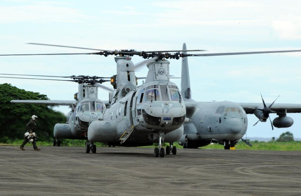 Two US helicopters used as air support at a temporary US Marine base south of Manila, where the Philippines has given US access to strengthen its defensive capabilities and maritime security (AFP Photo/Ted Aljibe)